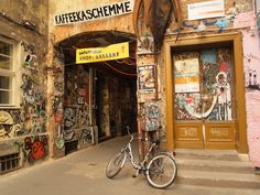 Berlin so much to see here -love the graffiti, bike, signs... and wonder where that walkway goes...