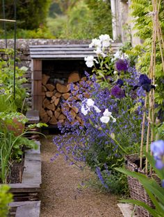 Log store, potager - Garden Designer Justin Spink Cottage Garden in the Cotswolds