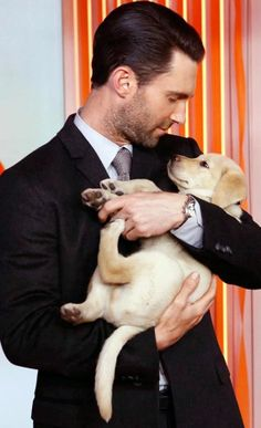 Adam Levine & the cutest little pup. I'd like this under my tree.