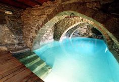 Indoor swimming pool in tunnel underneath house - This would be obscenely expensive, but I think the idea is pretty cool. Having a pool that resides in a tunnel underneath your house is wholly unnecessary, but a pretty dope idea in terms of indoor pools.