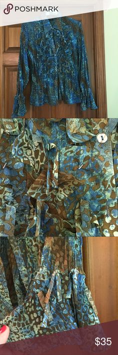 Gorgeous highly detailed blouse What a beauty. Details everywhere which I have tried to capture in the photographs.   The second photograph shows small tubular beads that are placed here and that are on the front of the blouse. Gives this just a touch of shimmer as you move your body.  The third photograph shows the lovely bell sleeve which is one of my favorite things about this blouse. There is stretch to this and can be worn tucked in or out.  I wore this a few times and every time got…