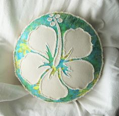 Tropical hibiscus applique pillow on peridot, aqua, and yellow batik and natural denim pillow. Natural denim is soft to the touch and fuzzy on the
