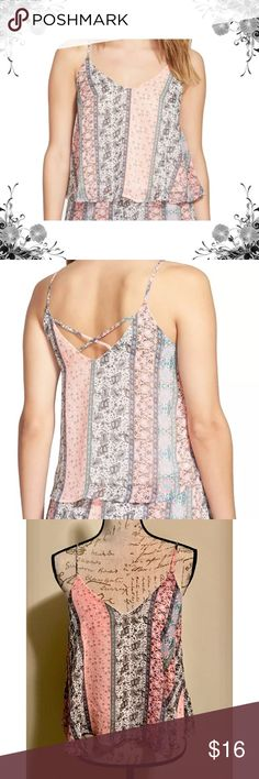 """Lush Cross-Back Detail Cami Swing Tank Mesh lined. Cross-back Detail. Beautiful Coral Paisley Print! Chest across from underarm to underarm is approx 19"""". Approx 12"""" from V-Neck to bottom hemline and approx 21"""" total length from top of strap to bottom hemline. 100% Polyester. Bundle for discounts! Thank you for shopping my closet! Lush Tops Tank Tops"""