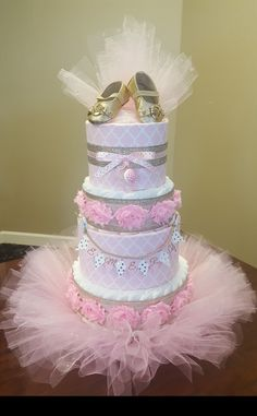 Pink and gold diaper cake, tutus and tiaras baby shower, gold Michael Kors baby shoes!!! Created by Kim Swinson, visit my Facebook page Simply Showers for more pics and orders.