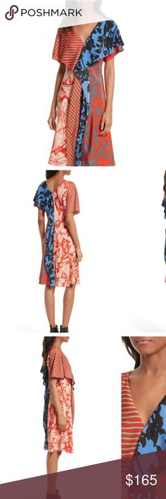 Used Once DVF  Mix Print Silk Ruffle Dress Used Once DVF DIANE VON FURSTENBERG Mix Print Silk Ruffle Dress sz 10 $595.   A mash-up of bold prints and cascading ruffle panels energize a fluid-silk dress in an oh-so-flattering A-line cut.  Slips on over head Surplice V-neck Short flutter sleeves V-back A-line silhouette Unlined 100% silk Dry clean Imported Diane Von Furstenberg Dresses Midi