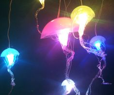 Hanging Jellyfish Lamps-Bring the majesty of the deep sea into your own home when you light up your room with the hanging jellyfish lamps. These astonishingly realistic lamps are handmade in various pastel colors and give off a soft glow as they gracefully float overhead.