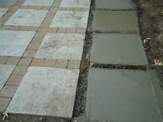 """Patio project.  Poured 2' x 2' concrete squares and put tumbled 6"""" x 6"""" pavers in between."""