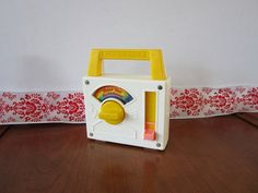 """Vintage Fisher Price Small Toy Radio-- Plays """"Over The Rainbow"""" (i carried this around with me EVERYWHERE when i was like 4..) $25 on Etsy"""