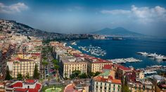 "Naples, formerly the capital of the ""Kingdom of the Two Sicilies"" before the unification of Italy in 1859-60, is a city with a rich cultural heritage that goes back more than 4,000 years. Today, it is the third largest city of Italy (after Rome and Milan) vibrant, carefree and, dare it be said, chaotic. 18 km from the vantage point of this photographer, Vesuvius looms over Naples, a constant reminder of danger. However, Vesuvius is perhaps the least dangerous of the three volcanic systems…"