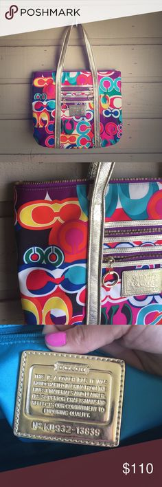 Coach Poppy Print Tote Bright amazing colors on this bag! Super fun, and perfect for traveling - you can literally throw everything you need in this bag. Inner state lining is in amazing condition. Overall the bag is in great condition, with exception to a few small spots and minor fading of the handles on the back of the bag. Coach Bags Totes