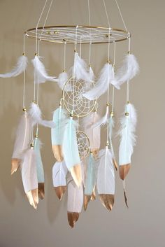 Baby Mobile, Woodland Feather Dreamcatcher Mobile, Gold Mint Blush Nursery Decor, Baby Boy Girl Nursery Mobile Catch happy dreams with this beautiful dream catcher mobile. Light and airy, a gently breeze makes the feathers flutter and dance. This beautiful baby mobile made on a