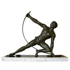 This iconic Art Deco sculpture was created by Jean de Roncourt, the most famous French sculptor of the male figure in the 1920s and 1930s. Entitled Le Bendeur (or, in English, The Bender), it depicts an athletic man dressed in a loincloth bending a large metal rod by hand.