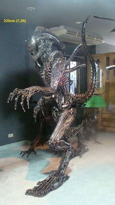 alien statue, life size scrap metal art from thailand