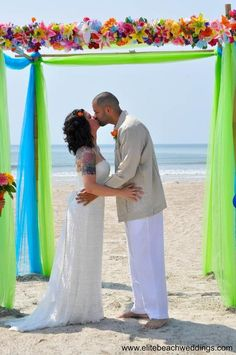 Floral and tropical bright colors at this Cocoa Beach, Florida destination wedding. Love the setup from www.elitebeachweddings.com