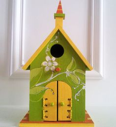 Vibrant Wood Birdhouse Indoor or Outdoor Hand Painted birdhouse with openable doors for outdoor gardens or home decor. $35.00, via Etsy.