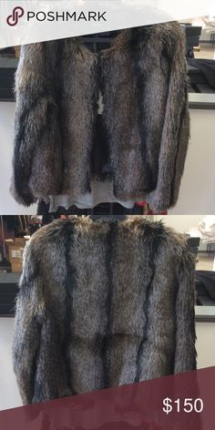 NWT Unrealfur Jacket This is a fresh take on Unreal Fur's classic. Go glam with bodycon dresses or keep casual with jeans and biker boots.  • Shell: 100% Mod Acrylic • Lining: 53% Polyester; 47% Viscose • L 55cm • Boxy cut • Hook and eye closures • Dry Clean Only unrealfur Jackets & Coats