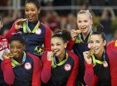 US women's gymnastics team wins gold in Rio. Clockwise from top left: Gabby Douglas, Madison Kocian, Aly Raisman, Laurie Hernandez, Simone Biles. Gymnastics Team, Artistic Gymnastics, Olympic Gymnastics, Gymnastics History, Gymnastics Stuff, Gymnastics Posters, Rhythmic Gymnastics, Usa Olympics, Rio Olympics 2016