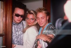 Marilyn with a young lady and Boy George. Marilyn and George are not wearing makeup; circa 1985; New York.