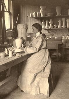 Pewabic co-founder Mary Chase Perry Stratton, above, works on a vase in her studio around 1905.