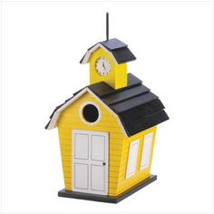 Any well-educated bird will see that this cheery schoolhouse is the perfect nesting place! Quaintly fashioned just like a 19th-century school building, complete with clock tower and sunny yellow paint.