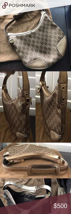Gucci Princy Small Shoulder Bag in Brown and Gold Authentic Gucci Princy small shoulder / hobo in rich brown silk satin with interlocking metallic G print and gold leather handle and trim. Very rare color! Gold leather bow on one side. Dark brown fabric interior with two pockets. Gold zipper closure. Used once and in excellent condition. Has one very small smudge on outside near the side of the bow (see last pic). Comes with original dust bag. Gucci Bags Shoulder Bags