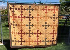 9 nine patch quilt made with Kansas troubles fabric.