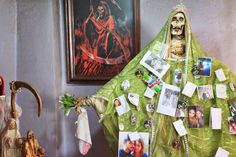 Our blessed mother of death, Santa muerte, green robe represents justice, the legal system, removal of oppression