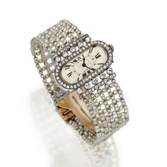 PLATINUM, GOLD, SEED PEARL AND DIAMOND WRISTWATCH, CARTIER, FRANCE, CIRCA 1920  The oval dial with Roman numerals, framed by numerous old European-cut and single-cut diamonds, the bracelet composed of numerous seed pearls, manual movement, dial signed Cartier and numbered 7843, caseback numbered 15304 and 3217, clasp signed 164, French assay marks.