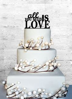 All You Need Is LOVE Wedding Cake Topper on Etsy, $17.00