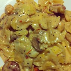Spicy Romano Chicken With Artichoke Hearts and Sundried Tomatoes Recipe Main Dishes with heavy cream, butter, salt, pepper, romano cheese, parmesan cheese, cayenne pepper, bow-tie pasta, melted butter, sliced mushrooms, artichoke hearts, grilled chicken, sun-dried tomatoes, heavy cream