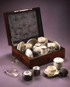 Afternoon tea travel set, consisting of French St. Cloud porcelain coffeepot, cup and saucers, sugar bowl, milk jug, metal canisters and glass containers (for coffee, chocolate, milk, sugar) all in a lined wooden carrying case.