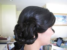 Side bun with pinned curls