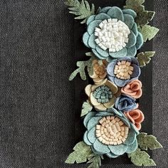 A close up of my miniature vertical flower garden Link in bio. #verticalgarden #flowergarden #miniaturegarden #miniatures #feltflowers #hanginggarden #wallart #wallhanging #bohowallhanging #bohochic #bohostyle #greyblue #turquoise #succulentgarden #succulentwallart #verticalsucculentgarden #finditstyleit #pocketofmyhome #dsfloral #dscolor #apartmenttherapy #craftspire #craftsposure #lukh #hellosmallshop #handmadeisbetter #etsylithuania #photooftheday #flowerpower #handmadehollow