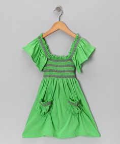Traditional meets fresh on this dress with its peasant cut, detailed stitching and vibrant hue. Lightweight and at the sleeves and skirt, this frock calls to sunny twirlers everywhere.100% cottonHand wash; hang dryImported