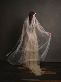 This is Louisa, a veil reminiscent of bygone eras. The veil is a soft ivory…