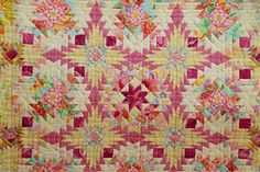 """Closeup of """"Start Again"""" by Kimie Yanagisawa, shown at the Jan 2011 Tokyo Quilt Festival. Note how she uses large scale fabrics, cutting into small pieces to integrate into the overall patchwork pattern."""