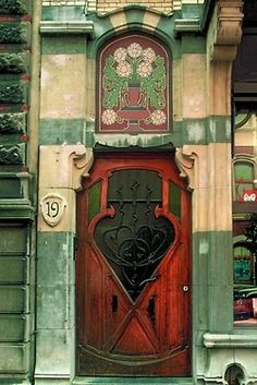 Art nouveau door in Brussels! -- It always frustrates me a little that the bottoms of the doors become so weathered. Cool Doors, The Doors, Unique Doors, Windows And Doors, Front Doors, Art Nouveau Arquitectura, Architecture Art Nouveau, House Architecture, Porte Cochere