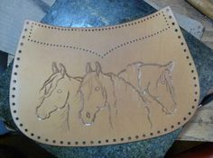 Horses in leather by Brenda Lovejoy