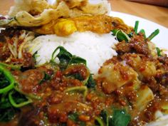 Indonesian food - Nasi pecel. It is a rice w/ delicious vegies and nut sauce :D
