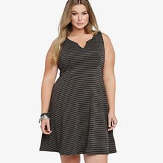 Torrid Textured Gray & Black Striped Skater Dress Wrapped in a textured ponte fabric, this black and grey striped dress has a slit V-neck and lined bodice. With the skater fit and flare you love, this sexy sleeveless looks perfect for festive gatherings. Dress worn only once. Is a Torrid size 2 (approx 18/20) torrid Dresses Midi