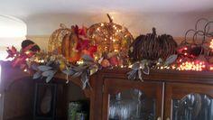 My Autumn decor on top of my kitchen cabinets.