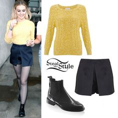 Perrie Edwards arrived at the Radio 1 Studios today in London with bandmate Leigh Anne Pinnock wearing a Monsoon Cara Cable Sweater (£27.50), a Topshop Tailored Satin Skort (sold out) and a pair of Russel & Bromley Cadogan Chelsea Brogues (£215.00). You can get similar boots from H&M ($49.95).