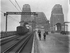 First cars and trains across Sydney Harbour Bridge, March 1932 / Sam Hood. AND BIKES!