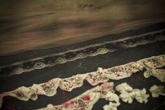 Great accent... bloodstained black-dyed lace.