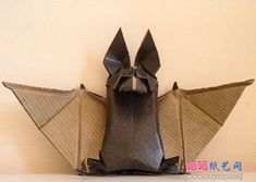 Let's keep getting in the Halloween mood, shall we? How about a roundup of origami bats? Source for those above Source Source Source Source Source Source Anyone have links to others, or examples of ones you've made? Origami Garland, Origami And Kirigami, Origami Ball, Paper Crafts Origami, Oragami, Dollar Origami, Origami Halloween, Origami Christmas, Origami Instructions