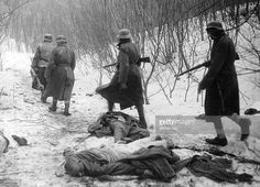 Hungarian soldiers pass by killed German soldiers on the Eastern Front, december 1941 - pin by Paolo Marzioli