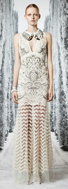 Sheer lace floor-length skirt with opaque dress at Roberto Cavalli.