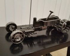 Rat Fink hot rod welded with caterpillar heavy equipment parts