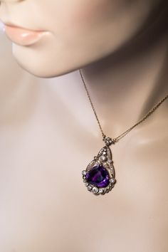 circa 1915 An antique Russian necklace features a superb, deep royal purple Siberian amethyst of an unusual pear shape. The amethyst is framed by sparkling Amethyst Jewelry, Amethyst Necklace, Amethyst Pendant, Amethyst Stone, Purple Amethyst, Diamond Jewellery, Stone Necklace, Purple Necklace, Colored Diamonds