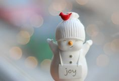 love the side-smile and red bird on this little snowman